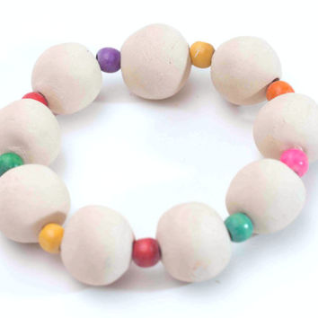 Ceramic trivet made from 9 white clay balls and colorful wooden beads