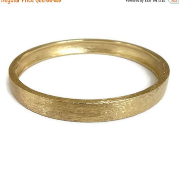 Monet signed Bangle Bracelet in a Brushed Gold Tone Finish Vintage