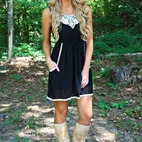 black sleeveless dress with crocheted lace detailing