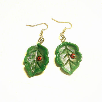 Green leaf earrings  with ladybug crafted by hand in cold porcelain