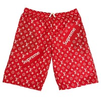 """LOUIE/SUP"" SWIM TRUNKS"