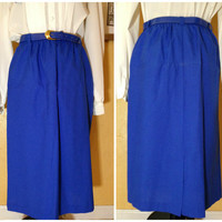 Blue 1968 Radcliff skirt with elastic waist and belt size 16