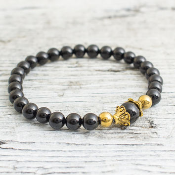 Black onyx beaded stretchy bracelet with gold caps, mens bracelet, womens bracelet