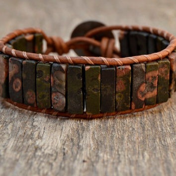 Natural beaded cuff. Rustic adjustable bracelet. Earthy column beads on leather