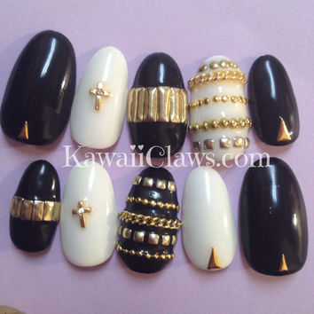 Black, white. & gold gel nails with crosses and lots of studs false/fake 3D nail art