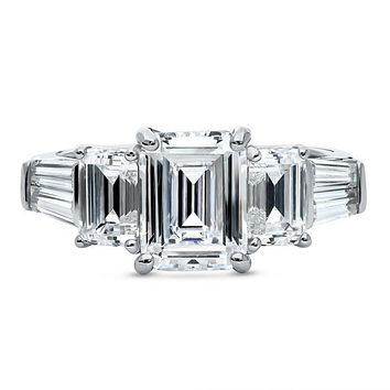 A Perfect 4.5TCW Emerald Cut Three Stone Journey Ring