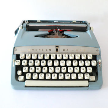 Working Typewriter, Brother Deluxe. In Good Cosmetic Condition. Include Portable Carry Case.