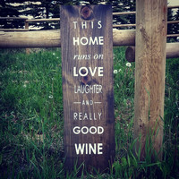 "Wood Sign ""This Home Runs On Love Laughter And Really Good Wine"""