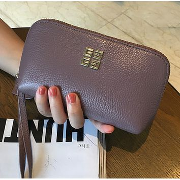 Givenchy new ladies first layer leather leather zipper clutch bag hand bag Purple