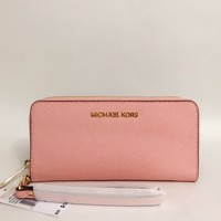 Michael Kors Mercer Tech Continental Saffiano Leather Wallet Wristlet Pale Pink