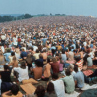 Seated Crowd Listening to Musicians Perform at Woodstock Music Festival Photographic Print by John Dominis at AllPosters.com