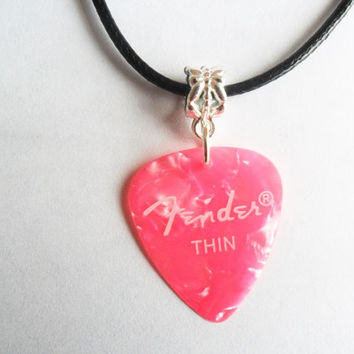 "Pink Fender guitar pick necklace that is adjustable from 18"" to 20"""