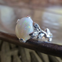 Opal leaf engagement ring.  14k white gold opal ring with diamonds.