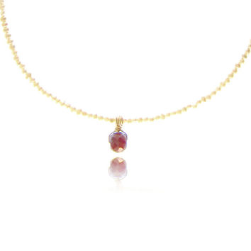 Balinese ruby pendant on a string of seed pearls  - 14kt gold fill wire wrapped bail.