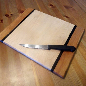 Handmade hardwood maple and cherry cutting board