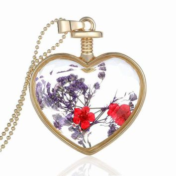 Heart Shaped Glass Pendant Filled With Dried Flowers