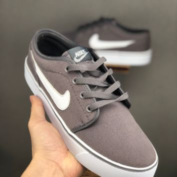 HCXX 19June 1057 Nike Toki I Low Cool canvas sneakers