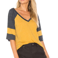 Chaser Blocked Jersey V Neck Tee in Marigold & Canopy | REVOLVE