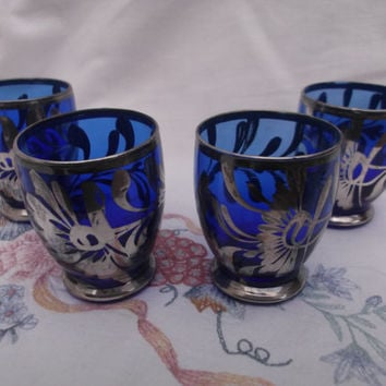 4 Vintage cobalt blue shot glasses with silver-tone detailing