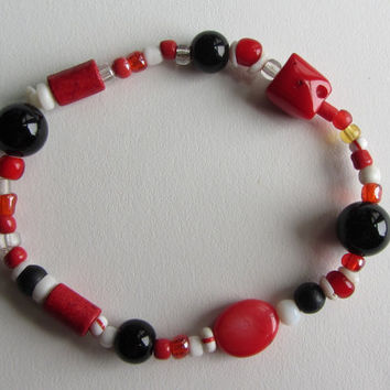 Ghanaian Glass, Sardinian Coral, Onyx, Greek Ceramic and Shell Beads Stretch Bracelet