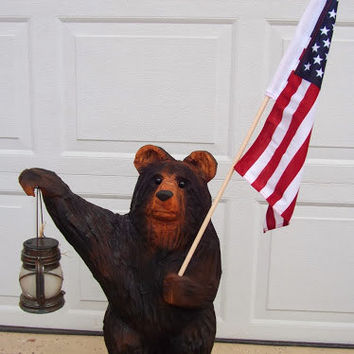 Black Bear Chainsaw Carving with American Flag and Solar Lantern