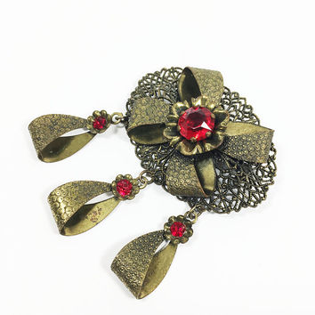 Art Deco Oval Filigree Brooch Stamped Brass Tone Red Rhinestone Flowers with Dangle Loops