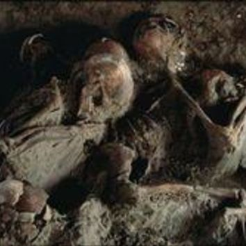 A close view of embracing skeletons excavated on Herculaneum's beach