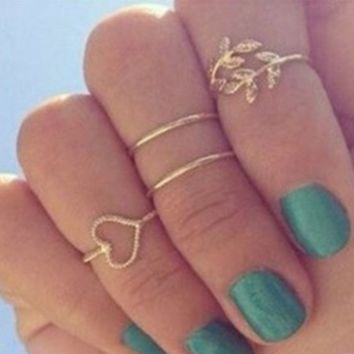 Fashion ladies silver and gold jewelry middle finger ring ring ring sweet heart leaves diamond