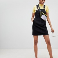 ASOS DESIGN Tall denim overall dress in washed black at asos.com