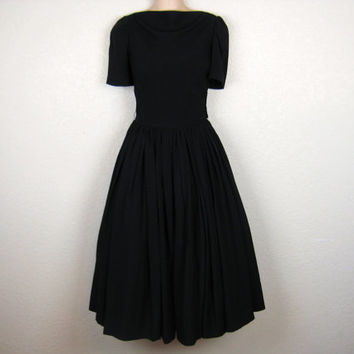 1950's black party dress. rayon / drooped neckline / full skirt cocktail dress. small / medium.
