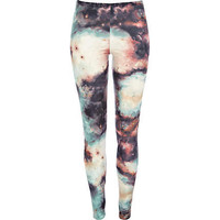 Green cosmic print leggings