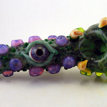 glass pipe purple glass eye dragon claw creature spoon