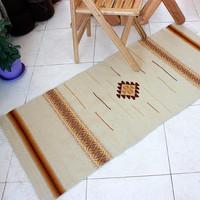 Boho handwoven wool rug in white and yellow-brownish rug, handmade rug with ancient symbols
