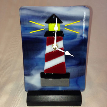 Handmade Fused Glass Lighthouse Desk Clock with white hands on a black wooden base