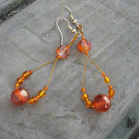 Orange beaded hypoallergenic earrings.