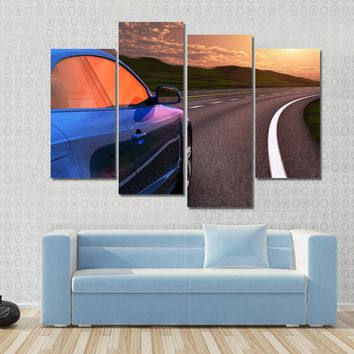 Blue Car Driving By Autobahn In Sunset With Motion Blur Effect Multi Panel Canvas Wall Art