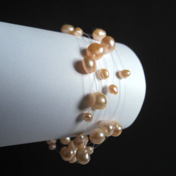 Pink Floating Pearl Bracelet by Lunarpearl on Etsy