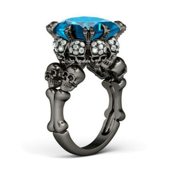 Rhodium Bones and Skull Ring Blue Gem Surrounded By Skulls