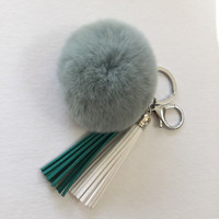 Fur pom pom keychain fur ball bag pendant charm made from Rex Rabbit Fur in baby green with two 3,5 inch leather tassels