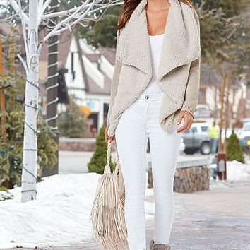 WINE Shearling knit cardigan, cami, jeans, boots, sunglasses, bag from VENUS