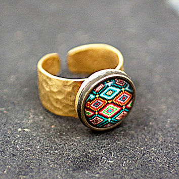 22k gold plated hammered ring, wide band with bright ethno patchwork motif. Adjustable.