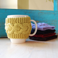Knit coffee cup cozy with cable pattern, hand knitted, green