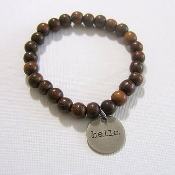 "Brown Wooden Bead Bracelet ~ 8 mm Beads ~ 3/4"" Antiqued Silver Metal Stamped Tag ~ Hello Travel Create World Wander ~Stretch, custom size"