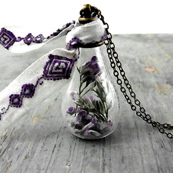Purple real sea lavender in glass drop with vintage embroidered trim. Long bronze chain. Romantic jewelry for her.