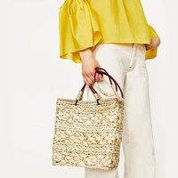 The new Bohemian style bag tropical style woven bag shoulder bag primary color  Straw handbag Ladies Big shopping bag