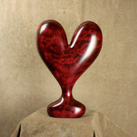 A loving red wood Heart Wedding gift Art Sculpture Wood Carving