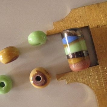 Lampworked glass bead set pink green and tan by HorkoverGlass
