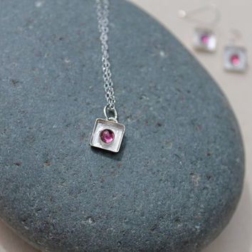 Pink Tourmaline Sterling Silver Bezel Set Shadow Box Necklace. Small frame. Pink Stone. Bright. textured background. tourmaline