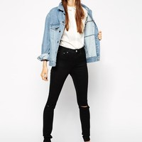 ASOS Petite | ASOS PETITE Ridley High Waist Ultra Skinny Jeans in Clean Black with Busted Knee at ASOS
