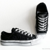 Black leather Converse low tops, vintage leather sneakers, low black trainers with white laces. Size 37 (UK 4.5, US wo's 6.5, US men's 4.5)